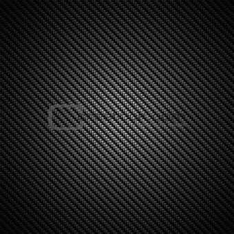 A realistic dark carbon fiber weave background or texture