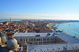 St. Mark's Cathedral in Venice from above with city roofs in dis