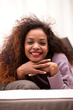 beautiful young black happy woman on a sofa