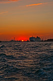 Venice Italy sunset with cruise boat