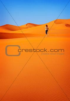 Woman in hot desert