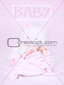 Newborn baby with teddy bear