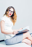 Beautiful young businesswoman working with documents