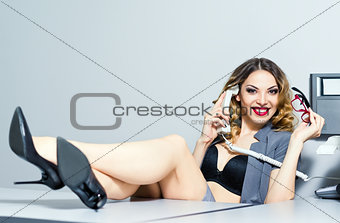 Beautiful smiling business woman talking on the phone