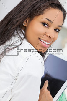 African American Woman Using Tablet Computer
