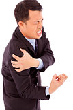 businessman having shoulder pain and painful expression