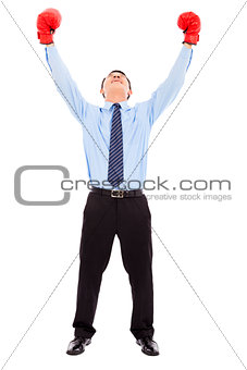 Excited businessman raises arms with gloves