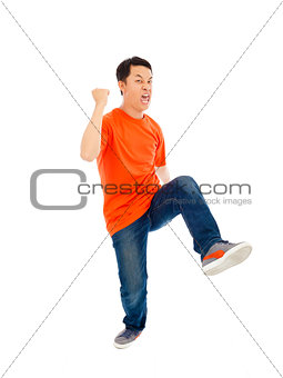 asian young man is dancing happily