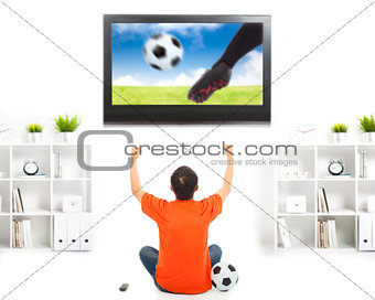 happy fan watching soccer game and raised hands