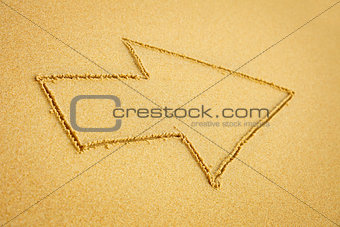 Arrow on beach sand