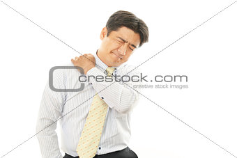 Businessman with shoulder pain