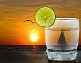 sunset cocktail with sailboat