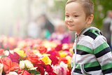 Little Boy With Easter Eggs And Flowers