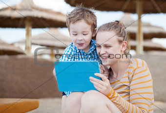 Happy mother and son at a beach resort