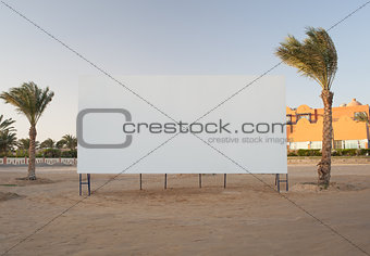 Blank billboard with palm trees