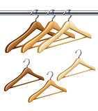 Wooden coat hangers on the tube for wardrobe clothes