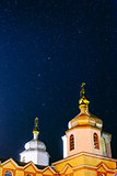 Christian church under the night sky with stars