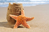 starfish and sandcastle on the beach