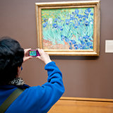 Person taking a picture of a painting, Getty Centre, Los Angeles, California, USA