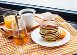 Breakfast with pancakes at the window