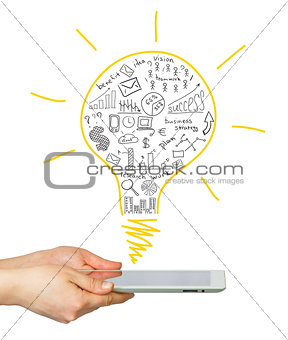 Hands holding a tablet with the sketch bulbs