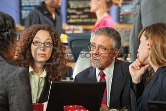 Business Man and Women in Cafe