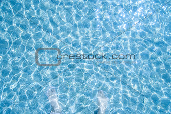 Blue sea water and  feet in water, background,