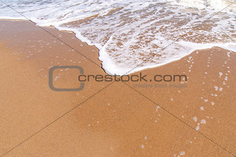 Beach  sand background. Wave and sand border.