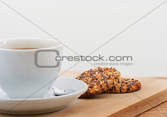 Cup of black coffee with butter biscuit