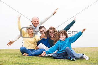 Happy family playing in the grass