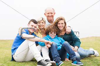 Happy family sitting in the lawn