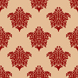 Ornate maroon damask style seamless pattern