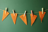 Burlap Pennants Hanging on a Green Chalkboard