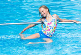 Girl in summer outdoor pool.