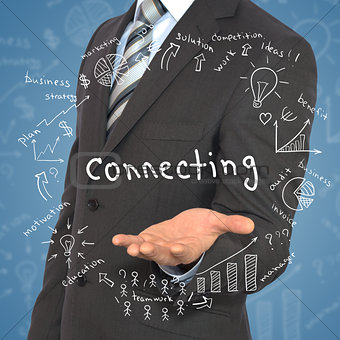 """Man in suit holding word """"connecting"""""""