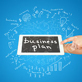 Hands, tablet and sketches business plan