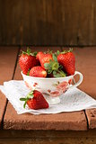 fresh juicy organic strawberries on wooden table rustic style