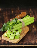 chopped green celery on a kitchen wooden board