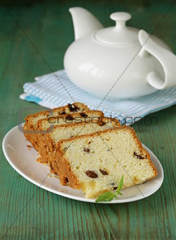 sliced cake with raisins on the plate