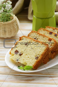 sliced ​​cake with raisins on the plate