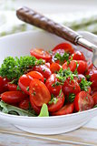 salad of small cherry tomatoes with parsley and olive oil