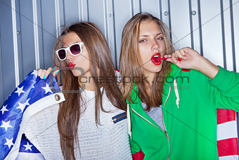Beautiful patriotic girls with lollipop