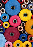 spools of thread of different size, texture and colour