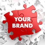 Your Brand Concept on Red Puzzle.