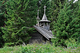 Old wooden chapel in the forest