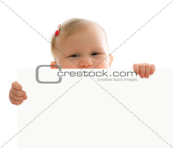 little baby behind white board