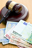 judge gavel and euro currency