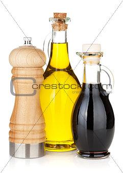 Olive oil and vinegar bottles with pepper shaker