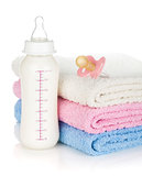 Baby bottle, pacifier and towels