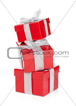 Three red gift boxes with silver ribbon and bow